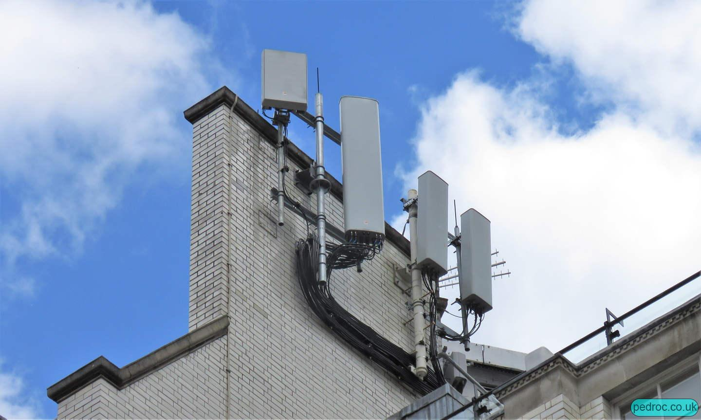 O2 are the left two panels, including Huawei massive MIMO for 5G. Vodafone have a pair of tri band Commscope panels.