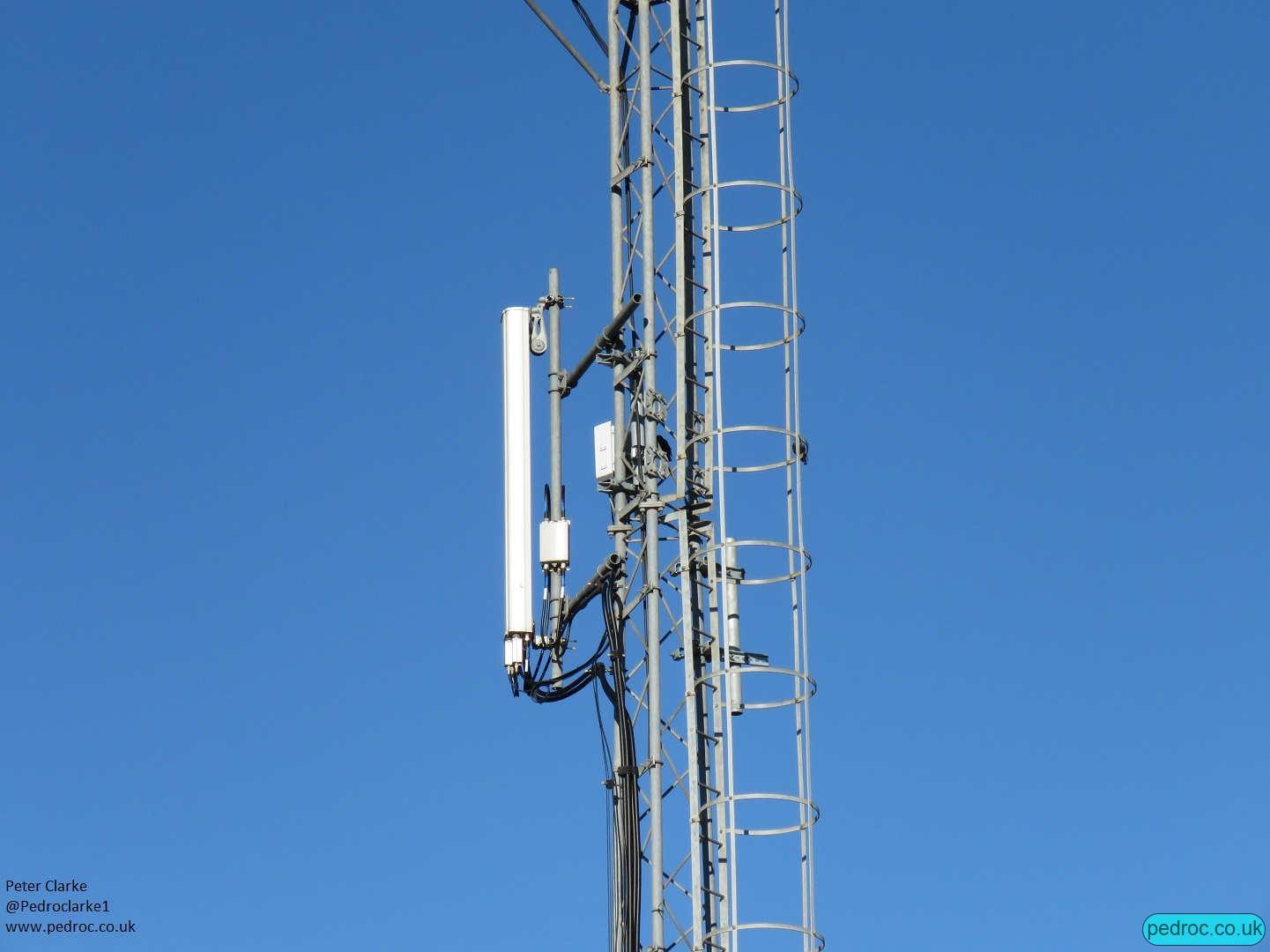 O2 Ericsson Site with kathrein antennas spread across two floodlight masts.