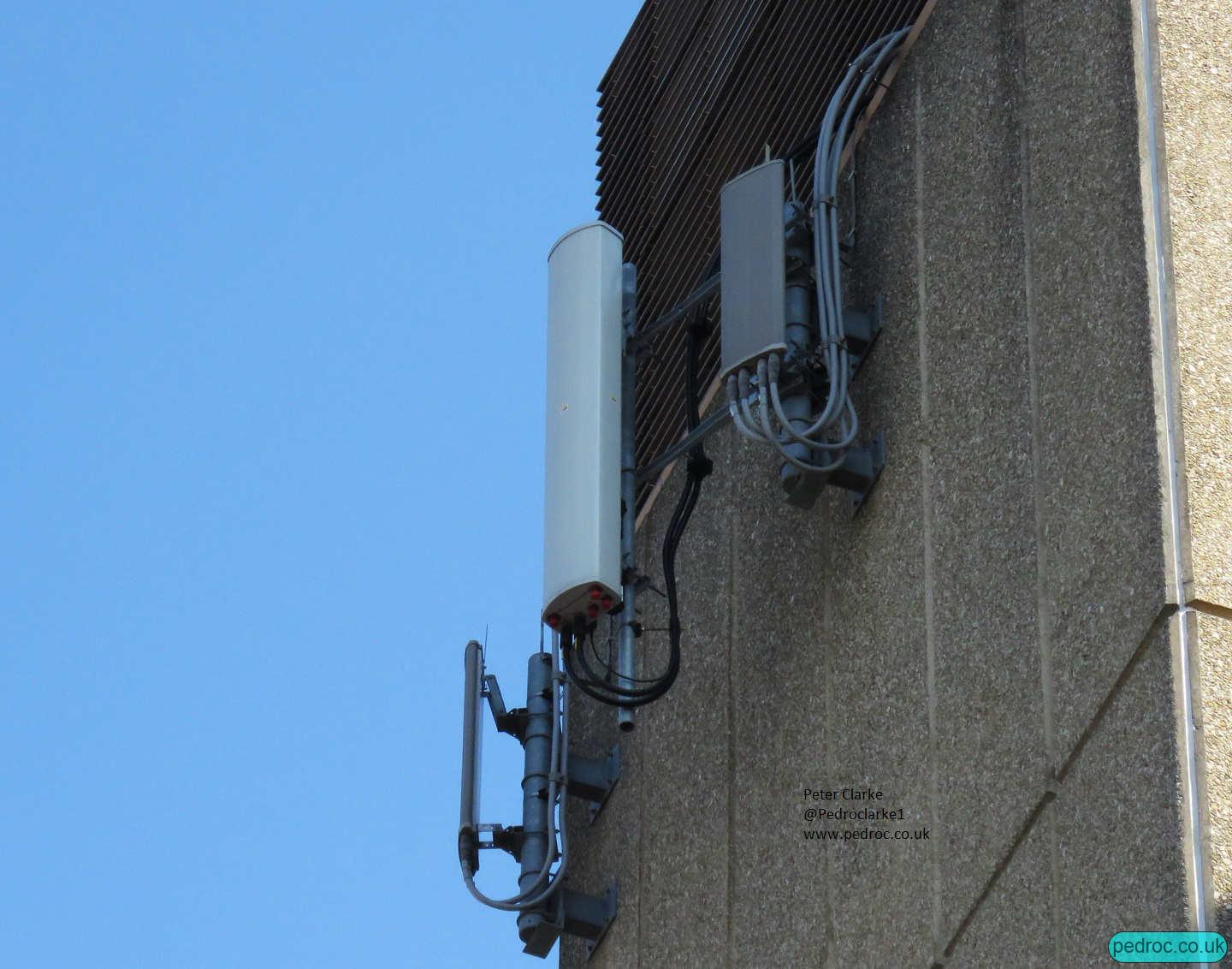 Commscope Tri-Band in between a pair of old Orange antennas on each sector of this site at St Crispins House Norwich.